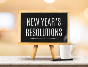 New Year's Resolutions Word On Blackboard With Easel On Marble T