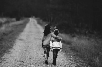 Canva - Children Walking on the Road